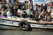 North Koreans use a fishing vessels as a passenger ferry in on the Yalu river separating China from north Korea, near the town of Sunuiju, Ocotber 11, 2006.  DPRK, north korea, china, dandong, border, liaoning, democratic, people's, rebiblic, of, korea, nuclear, test, rice, japan, arms, race, weapons, stalinist, communist, kin jong il