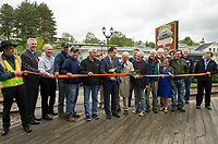Joined by the City of Laconia,  officials, designer McFarland Johnson, Contractors Busby Construction and the Weirs Community Mayor Ed Engler has the honor during the official ribbon cutting for the Lakeside Avenue Improvement Project on Thursday morning.  (Karen Bobotas/for the Laconia Daily Sun)