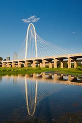 Reflection of Margaret Hunt Hill Bridge over the Trinity River, Dallas, Texas, USA.