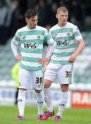 Dejection for Yeovil Town's Josh Sheenan and Yeovil Town's Stephen Kingsley - Photo mandatory by-line: Harry Trump/JMP - Mobile: 07966 386802 - 25/04/15 - SPORT - FOOTBALL - Sky Bet League One - Yeovil Town v Port Vale - Huish Park, Yeovil, England.