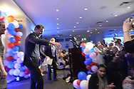 Garden City, New York, USA. November 6, 2018. Nassau County Democrats watch Election Day results at Garden City Hotel, Long Island.  Congressman TOM SUOZZI, accompanied on stage by his wife HELENE and their daughter and two sons, spoke after winning re-election as U.S. Representative for New York's 3rd district
