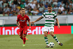 August 15, 2017 - Lisbon, Portugal - Sporting's defender Cristiano Piccini from Italy (R ) vies with Steaua's forward Catalin Golofca during the UEFA Champions League play-offs first leg football match between Sporting CP and FC Steaua Bucuresti at the Alvalade stadium in Lisbon, Portugal on August 15, 2017. Photo: Pedro Fiuza (Credit Image: © Pedro Fiuza via ZUMA Wire)