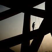 """A construction worker builds the """"Bird's Nest"""" National Stadium, which will be unveiled for the 2008 Summer Olympics."""