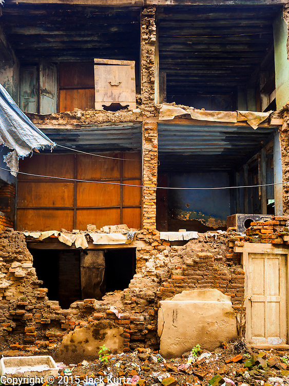 06 AUGUST 2015 - KATHMANDU, NEPAL:      The exterior wall of this home in the Thamel section of Kathmandu collapsed in the Nepal Earthquake. The Nepal Earthquake on April 25, 2015, (also known as the Gorkha earthquake) killed more than 9,000 people and injured more than 23,000. It had a magnitude of 7.8. The epicenter was east of the district of Lamjung, and its hypocenter was at a depth of approximately 15km (9.3mi). It was the worst natural disaster to strike Nepal since the 1934 Nepal–Bihar earthquake. The earthquake triggered an avalanche on Mount Everest, killing at least 19. The earthquake also set off an avalanche in the Langtang valley, where 250 people were reported missing. Hundreds of thousands of people were made homeless with entire villages flattened across many districts of the country. Centuries-old buildings were destroyed at UNESCO World Heritage sites in the Kathmandu Valley, including some at the Kathmandu Durbar Square, the Patan Durbar Squar, the Bhaktapur Durbar Square, the Changu Narayan Temple and the Swayambhunath Stupa. Geophysicists and other experts had warned for decades that Nepal was vulnerable to a deadly earthquake, particularly because of its geology, urbanization, and architecture.  PHOTO BY JACK KURTZ