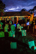 """Chris Baker's haunted yard (image from last year's display) in South Yarmouth, MA. Every year Baker sets up an elaborate Halloween display in his yard and on Halloween, neighborohood residents walk through his frightening """"vortex"""" of horror while trick or treating."""