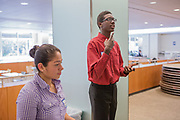 Purchase, NY – 31 October 2014. Samuel Brown, from Port Chester High School, practicing a presentation as Kimberly Chavarria listens. The Business Skills Olympics was founded by the African American Men of Westchester, is sponsored and facilitated by Morgan Stanley, and is open to high school teams in Westchester County.
