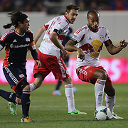 Thierry Henry, New York Red Bulls, is challenged by Lee Nguyen, (left), New England Revolution, during the New York Red Bulls V New England Revolution, Major League Soccer regular season match at Red Bull Arena, Harrison, New Jersey. USA. 20th April 2013. Photo Tim Clayton