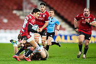 Santiago Carreras of Gloucester Rugby is tackled by Rusiate Tuima of Exeter Chiefs during the Gallagher Premiership Rugby match between Gloucester Rugby and Exeter Chiefs at the Kingsholm Stadium, Gloucester, United Kingdom on 26 March 2021.