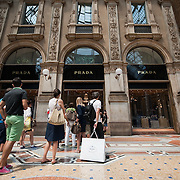 MILAN, ITALY - JULY 03:  Shoppers queue in front of the Prada store in Galleria Vittorio Emanuele II in Milan on the first day of the Summer Sales on July 3, 2010 in Milan, Italy. Milan's summer sales start today. .***Agreed Fee's Apply To All Image Use***.Marco Secchi /Xianpix. tel +44 (0) 207 1939846. e-mail ms@msecchi.com .www.marcosecchi.com