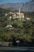 View of village and road on valley between mountains, Ponte Lucia, Corsica, France