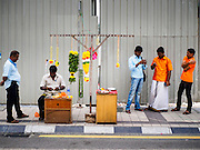 06 JUNE 2015 - KUALA LUMPUR, MALAYSIA: A garland vendor across the street from Sri Mahamariamman Temple, the oldest functioning and most important Hindu temple in Malaysia. The principal deity in the temple is Mariamman,  a deity that is popularly worshipped by overseas Indians, especially Tamils, because she is looked upon as their protector during the sojourn to foreign lands. Mariamman is a manifestation of the goddess Parvati, an incarnation embodying Mother Earth with all her terrifying force. She is associated with disease and fever and protects her devotees from unholy or demonic events.     PHOTO BY JACK KURTZ