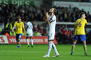 Swansea city's Michu looks to the heavens as Swansea press for a late equaliser. Barclays Premier league, Swansea city v Arsenal at the Liberty Stadium in Swansea on Saturday 28th Sept 2013.  pic by Andrew Orchard, Andrew Orchard sports photography.