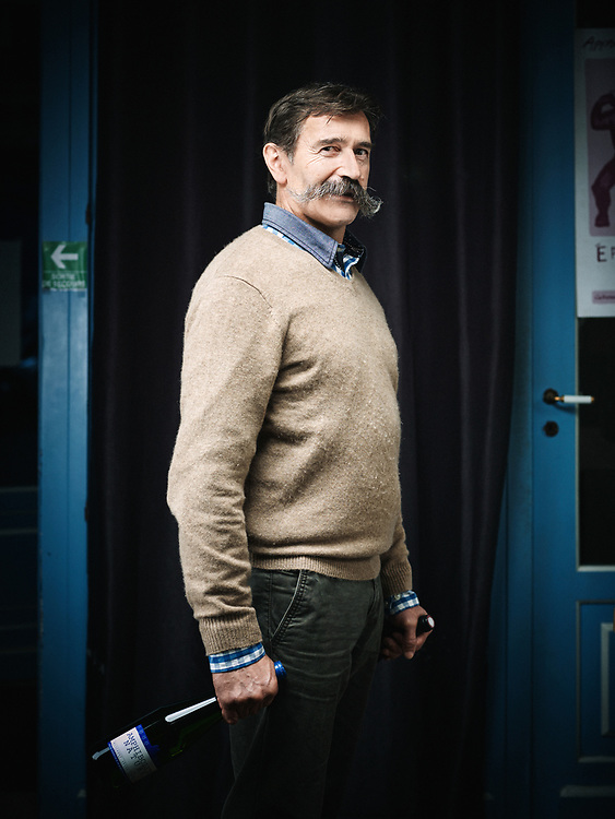 """Jo Landron, wine-grower in Muscadet, posing at a friend's wine store in Paris, """"L'Etiquette"""", a store that specializes in natural wines. Paris, France. November 26, 2014."""