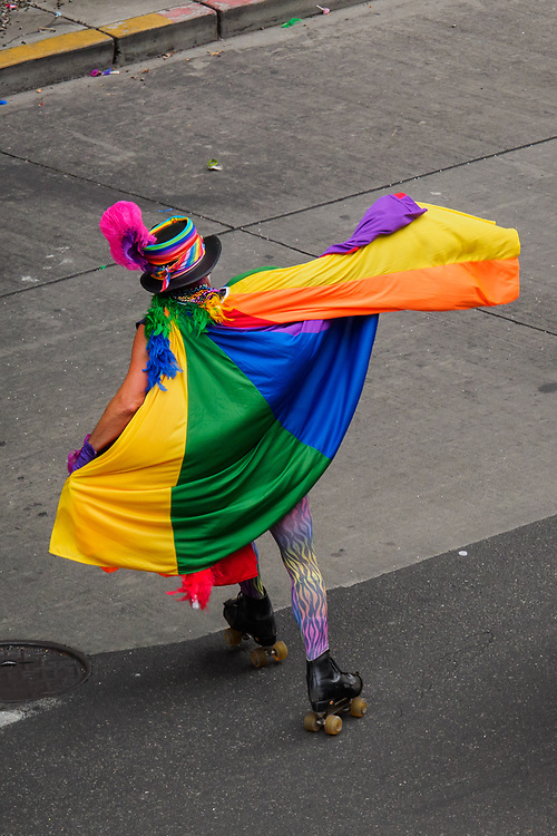 United States, Washington, Seattle Gay Pride Parade, June 28th, 2015. Man on roller skates with rainbow cape.