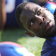 Justin Tuck stretching at the end of training during the 2013 New York Giants Training Camp at the Quest Diagnostics Training Centre, East Rutherford, New Jersey, USA. 29th July 2013. Photo Tim Clayton.