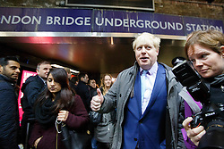 © licensed to London News Pictures. London, UK 05/02/2014. Mayor of Boris Johnson leaves London Bridge Underground Station on his way to City Hall during the 48 hour tube strike called by RMT Union on Wednesday, 5 February 2014. Photo credit: Tolga Akmen/LNP