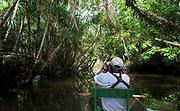 Canoo ride on Lake Mandicocha, a rainforest lake in central Ecuador.