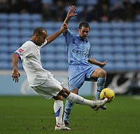 Photo: Lee Earle.<br /> Coventry City v Southend United. Coca Cola Championship. 30/12/2006. Southend's Lewis Hunt (L) battles with Michael Doyle.