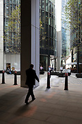 City workers walk through modern architecture in the City of London, (aka The Square Mile) the capital's financial district, on 2nd September 2019, in London, England.