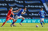 Cardiff City's Kieffer Moore (10) under pressure from Nottingham Forest's Ryan Yates (22) during the EFL Sky Bet Championship match between Cardiff City and Nottingham Forest at the Cardiff City Stadium, Cardiff, Wales on 2 April 2021.