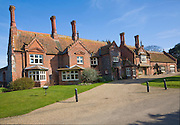 Estate buildings in village of Holkham, Norfolk, England