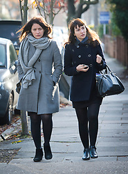 ©  London News Pictures. 26/11/2013. London, UK. Italian Sisters Elisabetta 'Lisa' (left) and Francesca (right, with handbag) Grillo, who are the former personal assistants to Charles Saatchi and Nigella  Lawson, arriving at Isleworth Crown Court in London. The pair, who face fraud charges, are accused of misappropriating funds while working for Saatchi and Lawson. Photo credit : Ben Cawthra/LNP