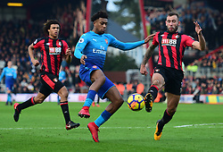Alex Iwobi of Arsenal is tackled by Steve Cook of Bournemouth - Mandatory by-line: Alex James/JMP - 14/01/2018 - FOOTBALL - Vitality Stadium - Bournemouth, England - Bournemouth v Arsenal - Premier League