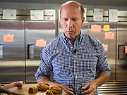 23 MAY 2019 - DES MOINES, IOWA: Congressman JOHN DELANEY (D-MD), tries a gluten free cookie at the Iowa Food Cooperative in Des Moines. He toured the co-op to help understand how Iowa farmers are finding new markets. Delaney is running to be the Democratic nominee for the US Presidency in the 2020 election and has visited all 99 of Iowa's counties. Iowa traditionally hosts the the first election event of the presidential election cycle. The Iowa Caucuses will be on Feb. 3, 2020.                         PHOTO BY JACK KURTZ