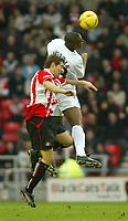 Photo. Andrew Unwin.<br /> Sunderland v Nottingham Forest, Nationwide League Division One, Stadium of Light, Sunderland 10/01/2004.<br /> Forest's Wes Morgan (r) outjumps Sunderland's Tommy Smith (l).