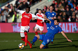 Leicester City's Aleksander Dragovic (right) challenges Fleetwood Town's Devante Cole during the FA Cup, third round match at Highbury Stadium, Fleetwood