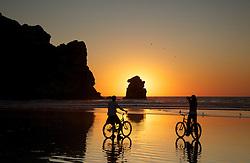 Bicyclers, Beach, sunset, Morro Rock, Morro Bay, California