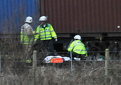 © Licensed to London News Pictures. 2/1/2013. Emergency services covering the body at the scene where a man died when his car is hit by a freight train on a level crossing  on Sandy Lane between Yarnton and Kidlington in Oxfordshire. The man was declared dead at the scene. Photo credit: MarkHemsworth/LNP