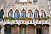Old window arches on balcony. Venice (Venezia), founded in the 400s AD, is capital of Italy's Veneto region, named for the ancient Veneti people from the 900s BC. The romantic City of Canals stretches across 100+ small islands in the marshy Venetian Lagoon along the Adriatic Sea, between the mouths of the Po and Piave Rivers. The Republic of Venice was a major maritime power during the Middle Ages and Renaissance, a staging area for the Crusades, and a major center of art and commerce (silk, grain and spice trade) from the 1200s to 1600s. The wealthy legacy of Venice stands today in a rich architecture combining Gothic, Byzantine, and Arab styles. Venice and the Venetian Lagoon are honored on UNESCO's World Heritage List.