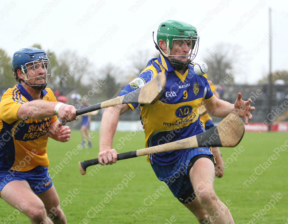 10/11/13  Newmarket On-Fergus's Martin O Hanlon breaks feels the pressure from Sixmilebridge's Kevin Lynch during the Senior Hurling County Final in Cusack Park. Pic Tony Grehan / Press 22