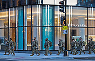 Troops in Washington DC on January 20, 2021 walking by Tiffany & Co.  after Biden's inuguration.