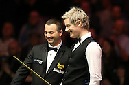 Neil Robertson of Australia shares a joke with the referee Terry Camilleri  after his sponsors logo badge falls off during play in the final against Ronnie O'Sullivan. Betvictor Welsh Open snooker 2016, Final day at the Motorpoint Arena in Cardiff, South Wales on Sunday 21st  Feb 2016.  <br /> pic by Andrew Orchard, Andrew Orchard sports photography.