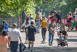 © Licensed to London News Pictures. 30/05/2021. London, UK. Public enjoy the sunny weather during bank holiday in Victoria Park, east London.  Photo credit: Marcin Nowak/LNP
