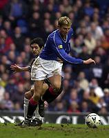 Rangers v Dunfermline, Scottish Premier.<br />pic Ian Stewart, February 3rd. 2001. Tore Andre Flo gets better of Gary Mason
