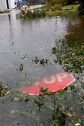 24 Sept, 2005. Orange, Texas. Hurricane Rita. <br /> <br /> A broken stop sign lies in the flood waters of the small Texan town of Orange.<br /> Photo; ©Charlie Varley/varleypix.com