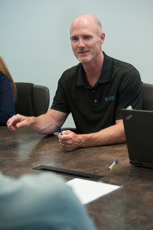 Jeff Ball is President and CEO of Visio Fianancial Services in Austin, Texas. He is seen here participating in a company meeting.   Photo by Mark Matson ( 8/7/15) .