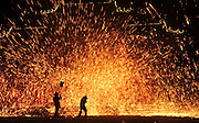ANYANG, CHINA - JANUARY 31: <br /> <br /> Artists perform Stunning iron fireworks <br /> <br /> Folk artists perform molten iron fireworks at a scenic area in Neihuang County to celebrate the Lunar New Year on January 31, 2017 in Anyang, Henan Province of China. Folk artists use planks hit the molten iron up to the sky to make fireworks in the celebrations. <br /> ©Exclusivepix Media