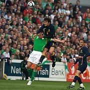 Mile Jedinak beats Kevin Doyle to the ball during the friendly International between Ireland and Australia at Thomond Park, Limerick, Ireland, Wednesday, August 12, 2009. Photo Tim Clayton..