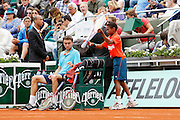 Roland Garros. Paris, France. June 1st 2012.A day with the ball boys..A ball boy bring Gilles Simon's rackets.