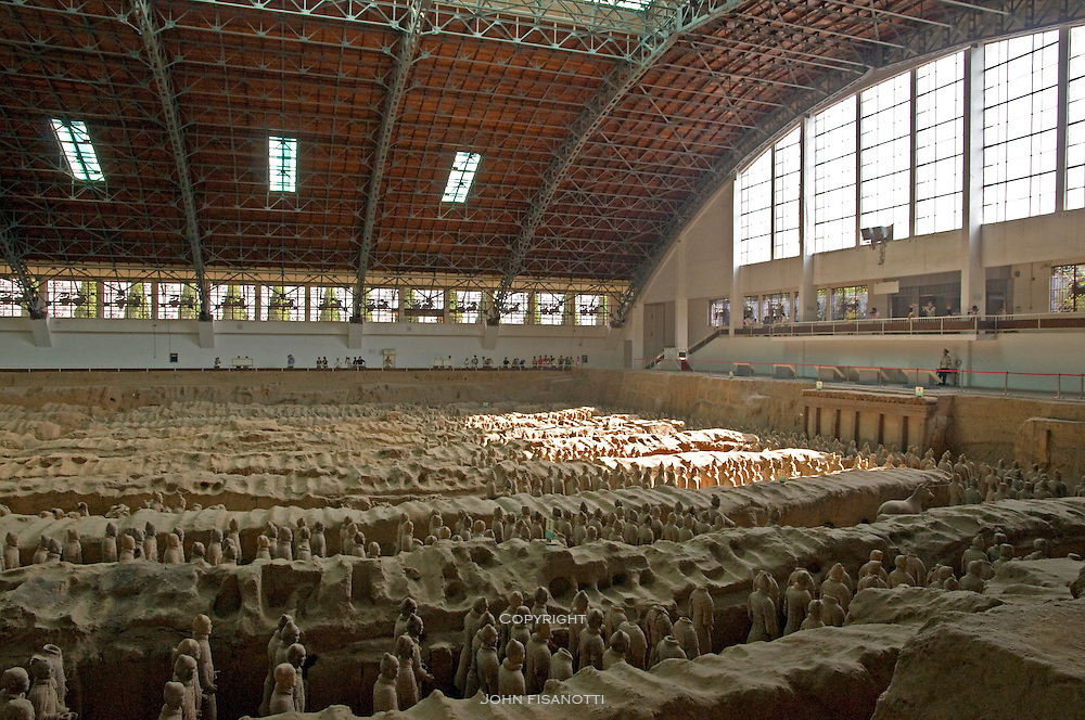 Terra Cotta Warriors of Emperor Qin Shi Huang's army stand guard in Pit No. 1, which is longer than a football field