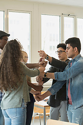 University student fists stacked on each other School, Bavaria, Germany