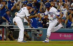 October 6, 2017 - Los Angeles, California, U.S. - Los Angeles Dodgers' Justin Turner (10) shakes hands with third base coach Chris Woodward (45) after hitting a three run home run against the Arizona Diamondbacks in the first inning of a National League Divisional Series baseball game at Dodger Stadium on Friday, Oct. 06, 2017 in Los Angeles. (Photo by Keith Birmingham, Pasadena Star-News/SCNG) (Credit Image: © San Gabriel Valley Tribune via ZUMA Wire)