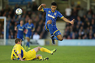 Lyle Taylor of AFC Wimbledon jumps over Tom Davies of Accrington Stanley. Skybet football league two play off semi final, 1st leg match, AFC Wimbledon v Accrington Stanley at the Cherry Red Records Stadium in Kingston upon Thames, Surrey on Saturday 14th May 2016.<br /> pic by John Patrick Fletcher, Andrew Orchard sports photography.