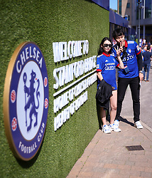 """Fans arrive a the ground during the Premier League match at Stamford Bridge, London. PRESS ASSOCIATION Photo. Picture date: Sunday August 27, 2017. See PA story SOCCER Chelsea. Photo credit should read: Scott Heavey/PA Wire. RESTRICTIONS: EDITORIAL USE ONLY No use with unauthorised audio, video, data, fixture lists, club/league logos or """"live"""" services. Online in-match use limited to 75 images, no video emulation. No use in betting, games or single club/league/player publications."""