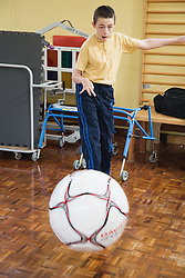 Boy with physical and learning disabilities exercising,