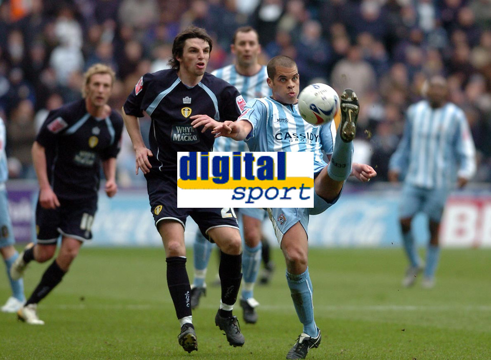 Photo: Leigh Quinnell.<br /> Coventry City v Leeds United. Coca Cola Championship. 18/03/2006. Coventrys Marcus Hall clears the ball from Leeds'  Jonathan Douglas.
